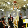Rob Winner – rwinner@shawmedia.com<br /> <br /> Kaneland's Trever Heinle puts up a shot in the second quarter of a Class 3A Sycamore Sectional semifinal on Tuesday, March 6, 2012.