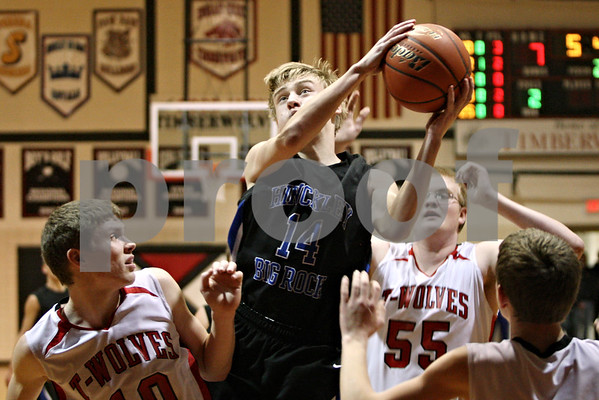 Rob Winner – rwinner@shawmedia.com<br /> <br /> Hinckley-Big Rock's Michael Bayler (14) controls an offensive rebound during the second quarter in Shabbona as Indian Creek hosted the Royals on Friday night.