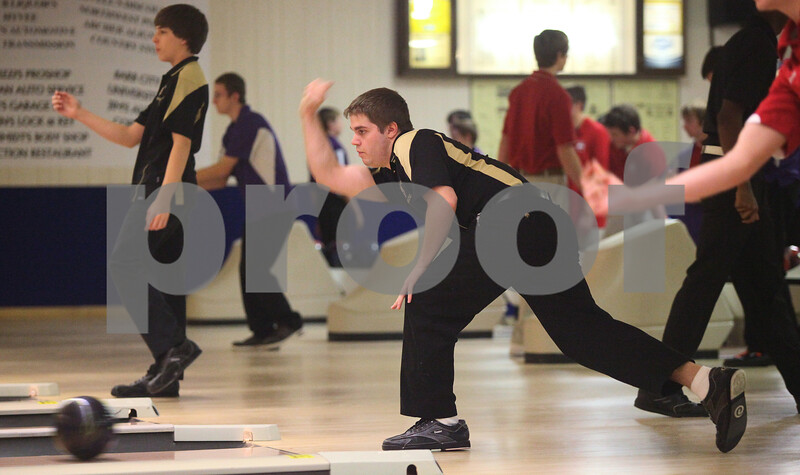 Kyle Bursaw – kbursaw@shawmedia.com<br /> <br /> Sycamore's Kody Williams (center) rolls at Four Seasons in Sycamore during the Northern Illinois Big 12 Conference Boys Bowling Tournament on Monday, Jan. 9, 2012.