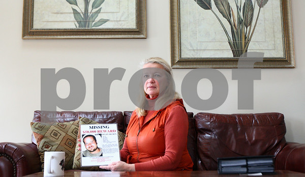 Kyle Bursaw – kbursaw@shawmedia.com<br /> <br /> Sue Olsen holds one of the laminated fliers with a photo and information about her son Bradley Olsen on it. <br /> Bradley Olsen disappeared five years ago on Jan. 20, 2007.<br /> <br /> Tuesday, Jan. 17, 2012.