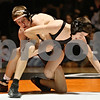 Rob Winner – rwinner@shawmedia.com<br /> <br /> DeKalb's Brad Green tries to control Sycamore's Brendon McGehee during their 120-pound match in DeKalb on Thursday, Jan. 12, 2012.