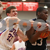 Rob Winner – rwinner@shawmedia.com<br /> <br /> Hinckley-Big Rock's Mitchell Hemesath (left) and Chicago Hope's Torrance Johnson struggle for possession in the second quarter of a Class 1A Mooseheart Sectional semifinal on Tuesday night.