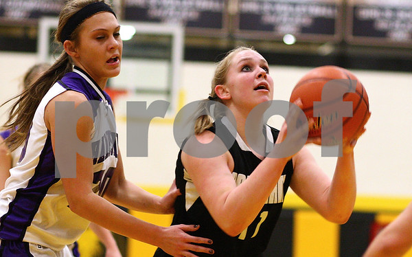 Kyle Bursaw ? kbursaw@shawmedia.com<br /> <br /> Kaneland forward Ashley Prost goes up for a shot with Hampshire's Elizabeth Panzica guarding in the first quarter at Sycamore High School on Monday, February 20, 2012.