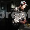 Kyle Bursaw – kbursaw@shawmedia.com<br /> <br /> Matt Jordan peels an orange in his parents' kitchen while prepping his lunch for work on Friday, Dec. 16, 2011.