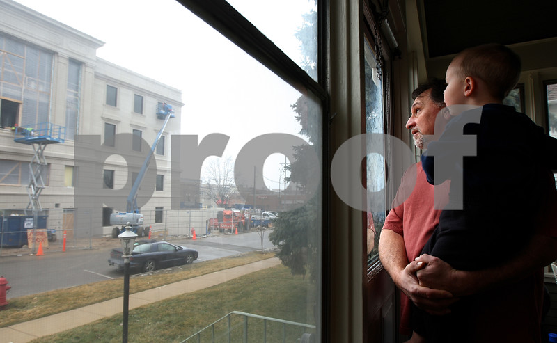Kyle Bursaw – kbursaw@shawmedia.com<br /> <br /> Steve King has had the view from his front porch altered as a result of the courthouse expansion. King, pictured with his two-year-old grandson Brandon Ziegler, also has concerns that West Exchange Street may become a two-way. <br /> <br /> Taken on  Thursday, Feb. 2, 2012.