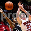 Kyle Bursaw – kbursaw@shawmedia.com<br /> <br /> Northern Illinois guard Courtney Shelton reacts to a foul by Western Michigan guard Aurielle Anderson in the first half of the game at the Convocation Center on Tuesday, Feb. 28, 2012.