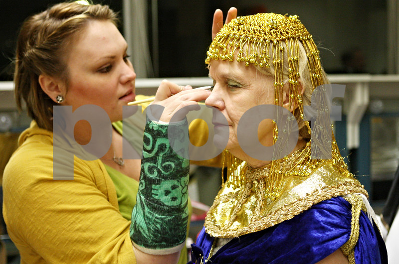 """Rob Winner – rwinner@shawmedia.com<br /> <br /> Danielle Pagoria (left) applies makeup to Chris Welch before rehearsal of """"Joseph and the Amazing Technicolor Dreamcoat ,"""" at Northern Illinois University's O'Connell Theatre, Stevens Building on the DeKalb campus on Tuesday night."""