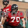 Rob Winner – rwinner@shawmedia.com<br /> <br /> Logan Pegram of the offensive line works out with teammates during the first spring practice of the Northern Illinois football team Wednesday.
