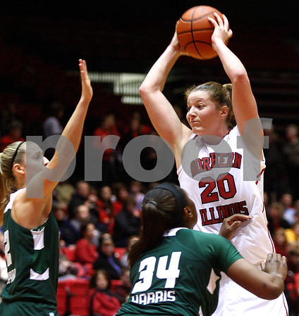 Kyle Bursaw – kbursaw@shawmedia.com<br /> <br /> Northern Illinois forward Jenna Thorp looks to pass while being defended by Ohio players Mariah Byard (left) and Porsha Harris in the first half of the game at the Convocation Center on Saturday, Feb. 4, 2012.