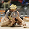 Rob Winner – rwinner@shawmedia.com<br /> <br /> Sam Sommer (top), of Clinton Rosette Middle School in DeKalb, competes with John Shobe, of Clinton Junior High School in Clinton, during a 112-pound match at the Illinois Elementary School Association wrestling tournament held at the Convocation Center in DeKalb on Saturday.