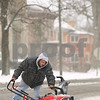 Kyle Bursaw – kbursaw@shawmedia.com<br /> <br /> Sam Pappas redirects his snow blower for a pass in the other direction while removal the snow at a Sycamore business on Thursday, Jan. 12, 2012. Pappas has a lawn care and snow removal business based in DeKalb.