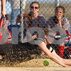 Kyle Bursaw – kbursaw@shawmedia.com<br /> <br /> Sycamore's Brittany Huber dives for a foul along the first base line but can't come up with it during the game against Ottawa at Sycamore Park on Monday, March 19, 2012. Ottawa defeated Sycamore 2-1.