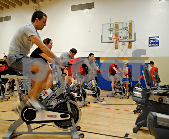 Athletes do a timed cycle Sunday at the Kishwaukee Family YMCA in Sycamore during the seventh annual Indoor Triathlon. Swimming and running were also part of the triathlon.<br /> <br /> By Nicole Weskerna - nweskerna@shawmedia.com