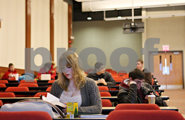 Rob Winner – rwinner@shawmedia.com<br /> <br /> Northern Illinois students including freshman Laura Stuehm await the start of a microeconomics class within Jameson Auditorium at Cole Hall on Thursday afternoon.<br /> <br /> DeKalb, Ill.<br /> Thursday, Feb. 9, 2012