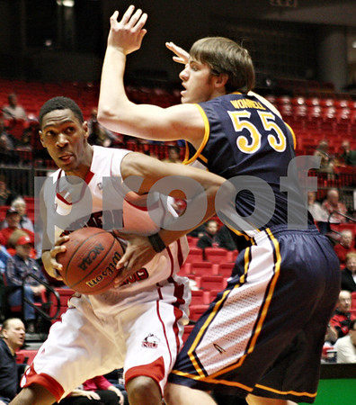 Rob Winner – rwinner@shawmedia.com<br /> <br /> Northern Illinois forward Kevin Gray moves past Toledo center Richard Wonnell for the Huskies' first basket during the first half in DeKalb on Wednesday, Feb. 29, 2012.