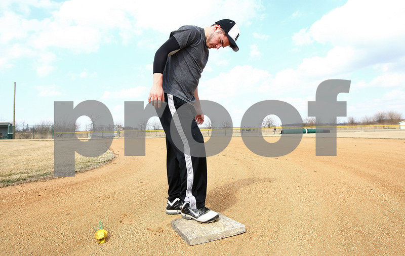 Kyle Bursaw – kbursaw@shawmedia.com<br /> <br /> Zack Martinelli secures second base into the dirt before the start of practice at Kaneland High School in Maple Park, Ill. on Wednesday, March 14, 2012.