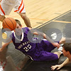 Rob Winner – rwinner@shawmedia.com<br /> <br /> Rochelle's Will Widick looks to recover a loose ball under the Barbs' basket during the first quarter in DeKalb on Friday, Feb. 17, 2012. DeKalb defeated Rochelle, 69-67.