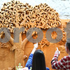Kyle Bursaw – kbursaw@shawmedia.com<br /> <br /> Rhodora Collins, the DeKalb County Farm Bureau Agriculture Literacy Coordinator, and Jim Hendricks, a retired NIU professor and self-proclaimed farm boy, search for birds in the tree of the wood carving, which is more than 32-foot-wide, at the Farm Bureau's open house in Sycamore, Ill. on Thursday, March 29, 2012.