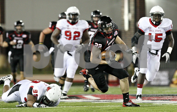 Rob Winner – rwinner@shawmedia.com<br /> <br /> Northern Illinois wide receiver Jamison Wells carries the ball after a reception during the first quarter in DeKalb, Ill., on Tuesday, Nov. 15, 2011.
