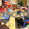 Kyle Bursaw – kbursaw@shawmedia.com<br /> <br /> Aidan Nehring, a third-grader in Katie Algrim's class at West Elementary, raises his hand with a question as he and other students work independently on their laptop computers on Thursday, Jan. 26, 2012. Each student in Algrim's nearly paperless classroom has a laptop computer.