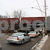 ANDREW MITCHELL — amitchell@shawmedia.com<br /> Traffic backs up Wednesday along Pearl Street in DeKalb. Motorists had to find their way around a freight train stalled on the tracks due to a broken couplings between railcars.