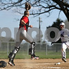 Rob Winner – rwinner@shawmedia.com<br /> <br /> Indian Creek catcher Robert Johnson (left) steps on home plate ahead of Hinckley-Big Rock baserunner Luke Winkle for a force out during the bottom of the third inning Tuesday in Big Rock.