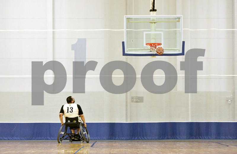 Rob Winner – rwinner@shawmedia.com<br /> <br /> Ramon Medina of the Chicago Hornets practices shooting before a wheelchair basketball game hosted by the Northern Illinois Presidential Commission on Persons with Disabilities and the Center for Access-Ability Resources at the NIU Student Recreation Center in DeKalb Thursday evening.