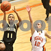 Rob Winner – rwinner@shawmedia.com<br /> <br /> After a steal Sycamore's Lake Kwaza goes up for a layup during the first quarter in DeKalb on Thursday, Feb. 9, 2012.