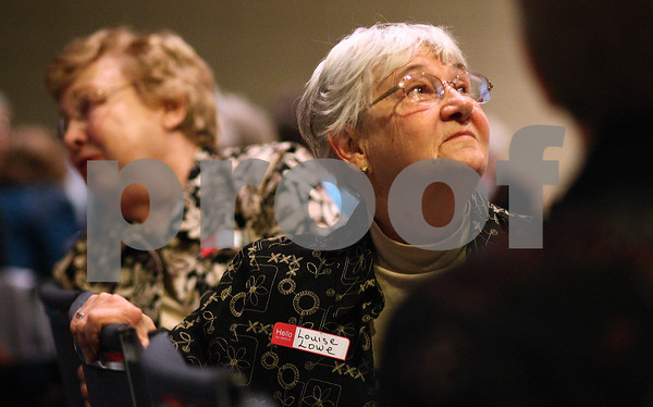Kyle Bursaw – kbursaw@shawmedia.com<br /> <br /> Louise Lowe listens as someone from her small group of other women speaks during a period of personal reflection and sharing during the World Day of Prayer ceremony at the Salvation Army in DeKalb, Ill. on Friday, March 2, 2012.