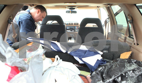 Kyle Bursaw – kbursaw@shawmedia.com<br /> <br /> John Holiday, with the DeKalb County Sheriff's office, searches through a vehicle at the site of an arrest in DeKalb, Ill. on Thursday, Feb. 23, 2012. The DeKalb Police, with assistance from the Sheriff's Office and Sycamore police, made numerous drug-related arrested throughout the day.