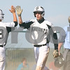Kyle Bursaw – kbursaw@shawmedia.com<br /> <br /> Kaneland's Jacob Razo (88) greets teammate John Hopkins as he comes in for a run in the first inning of the game against Rochelle at Kaneland High School in Maple Park on Thursday, April 12, 2012.
