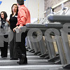 "Kyle Bursaw – kbursaw@shawmedia.com<br /> <br /> YMCA employees (from left) Rachel Beach, Katrina Luetkebuenger and Charlie Irick talk on the treadmills at the grand opening of the new satellite site dubbed ""DeKalb Barb City YMCA at Huntley Middle School"" on Thursday, Jan. 19, 2012."