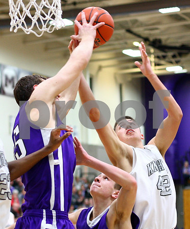 Kyle Bursaw – kbursaw@shawmedia.com<br /> <br /> Kaneland's Matt Limbrunner battles Rochelle's David Newton for a rebound. <br /> Kaneland defeated Rochelle 65-61at Rochelle Township High School on Friday, March 2, 2012. The regional championship is the first for Kaneland under third-year coach Brian Johnson.