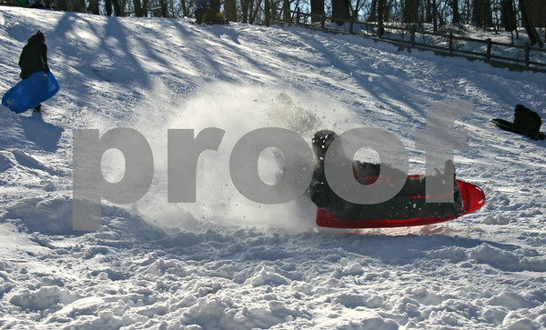 After nearly a half foot of snow fell Friday, sledders took to the hill at Russell Woods Forest Preserve in Genoa, where annual Winterfest activities took place.<br /> <br /> By Nicole Weskerna - nweskerna@shawmedia.com