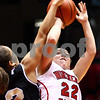 Kyle Bursaw – kbursaw@shawmedia.com<br /> <br /> Northern Illinois guard Amanda Corral gets off a shot over the outstretched arm of Western Michigan guard Corie Buchanan in the second half of the Huskies' 66-64 loss to Western Michigan on Tuesday, Feb. 28, 2012.