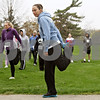 Rob Winner – rwinner@shawmedia.com<br /> <br /> Lisa Bogie of Oregon stretches before the start of the second annual Hustle for Hearing 5K run/walk Saturday morning at Hopkins Park in DeKalb. The Student Academy of Audiology hosted the event with RAMP's Deaf and Hard-of-Hearing chosen as the beneficiary of the event.