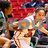 Kyle Bursaw – kbursaw@shawmedia.com<br /> <br /> Northern Illinois guard Amanda Corral drives toward the basket while being defended by Ohio guard Ashley Fowler in the second half of the game at the Convocation Center on Saturday, Feb. 4, 2012.