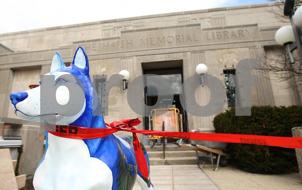 Kyle Bursaw – kbursaw@shawmedia.com<br /> <br /> The Huskie statue in front of the DeKalb Public Library anchors one end of red tape preventing patrons from entering on that side on Wednesday. The Oak Street entrance is closed for marble restoration, but the library will still be open and can be entered by using the 3rd Street door or the handicap access door on the east side of the building.<br /> <br /> Wednesday, March 7, 2012.