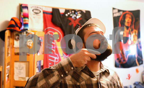 Kyle Bursaw – kbursaw@shawmedia.com<br /> <br /> Matt Jordan, 26, combs his beard in his bedroom on Friday, Dec. 16, 2011, part of his regular routine to get ready for work.