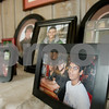Rob Winner – rwinner@shawmedia.com<br /> <br /> A table filled with photographs of Kevin Ballantine and his family is seen inside the Ballatine's DeKalb home on Saturday afternoon.