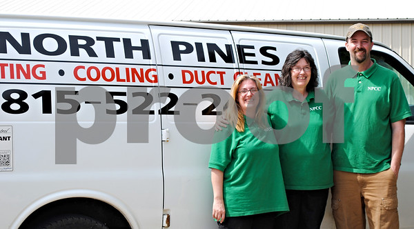From left, Janet, Janice and Jerry Sheehan stand in front of a North Pines Climate Control van, which is parked outside of their new building in Genoa. The Kirkland business expanded to a second location through the Genoa Springboard business incubator program.<br /> <br /> By Nicole Weskerna - nweskerna@shawmedia.com
