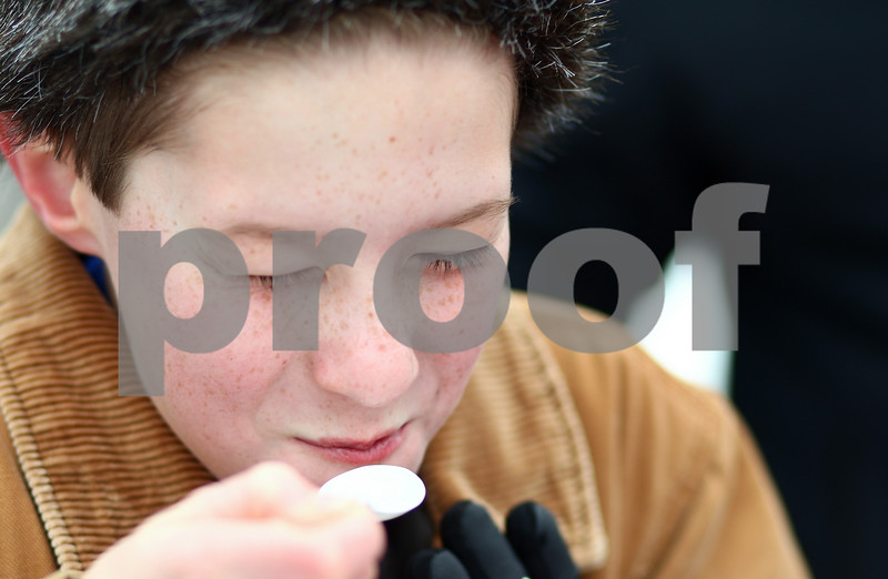 Kyle Bursaw – kbursaw@shawmedia.com<br /> <br /> Cliffton Hansen, 12, reacts to the sweetness of a spoonful of maple syrup cooked down in the Russell Woods Forest Preserve for Maple Syrup Fest in Genoa, Ill. on Saturday, March 3, 2012.