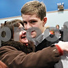 "Rob Winner – rwinner@shawmedia.com<br /> <br /> Carole Rydecki (left) congratulates her son Ben Rydecki, 14 of Somonauk Middle School, after Ben won the DeKalb County Spelling Bee at Kishwaukee College on Saturday, Feb. 25, 2012. ""Oratorio"" was the winning word of the spelling bee which lasted 14 rounds."