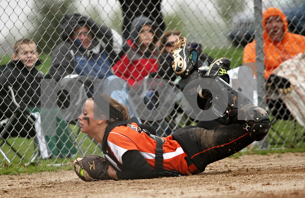 Rob Winner – rwinner@shawmedia.com<br /> <br /> DeKalb catcher Alysha Guy makes a diving catch to catch a foul ball during the top of the third inning Friday in DeKalb.  DeKalb defeated Streamwood, 10-0, in six innings.