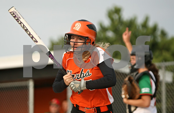 Rob Winner – rwinner@shawmedia.com<br /> <br /> DeKalb batter Tori Voorhis heads back to the dugout after striking out during the bottom of the fourth inning Tuesday in DeKalb. LaSalle-Peru defeated DeKalb, 8-1.