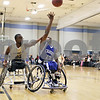 Rob Winner – rwinner@shawmedia.com<br /> <br /> Joel Adams (left) of the Chicago Hornets attempts to block a shot by the Rockford Chariots' Derrick Dortch during a wheelchair basketball game hosted by the Northern Illinois Presidential Commission on Persons with Disabilities and the Center for Access-Ability Resources at the NIU Student Recreation Center in DeKalb Thursday evening.
