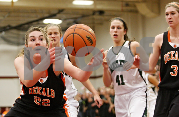 Rob Winner - rwinner@shawmedia.com<br /> <br /> DeKalb's Emily Bemis (22) reaches for a loose ball under the Barbs' basket in the second quarter during the Class 4A Elgin Super-Sectional on Monday, February 27, 2012.