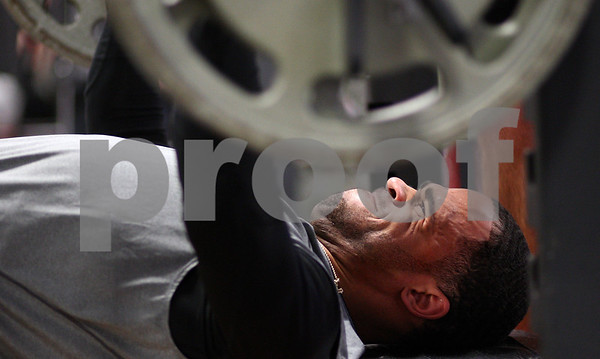 Kyle Bursaw – kbursaw@shawmedia.com<br /> <br /> Former Northern Illinois player DeMarcus Grady benches for NFL scouts in the weight room of the Yordon Center during the NIU Pro Day on Friday, March 9, 2012.