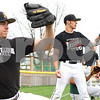 Kyle Bursaw – kbursaw@shawmedia.com<br /> <br /> Sycamore baseball players Matt Godinsky (left) and Mitchell Jordan(center) warm up their throwing arms at practice on Friday, March 23, 2012.