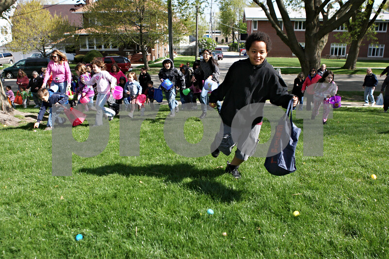 Rob Winner – rwinner@shawmedia.com<br /> <br /> Devonte Merrick, 11, is off and running to collect plastic eggs filled with treats as an Easter egg hunt gets underway at Huntley Park hosted by the First Baptist Church of DeKalb Saturday.